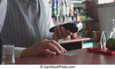 Accepting customer's payment with credit card - Man working...