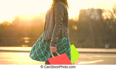 Woman holding her shopping bags in her hand - Let's go...