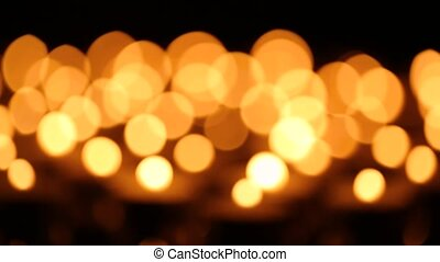Bokeh set of burning candles in the dark - Bokeh set of many...