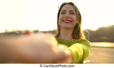 Follow me - happy young woman pulling guy's hand - hand in...
