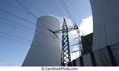 Industrial Cooling Towers With Electrical Pylon Timelapse -...