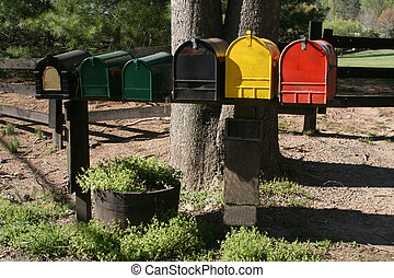 Mailboxes - Line of colorful mailboxes on a rural postal...