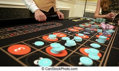 croupier collects chips  in casino.