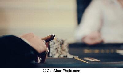 poker, a man Smoking a cigar, a player is nervous - poker, a...