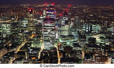 Elevated view of the financial district of London at night,...