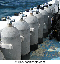 Steel scuba tanks on the dive boat