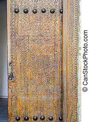Old ornamental door, Khiva - Old ornamental carved wooden...
