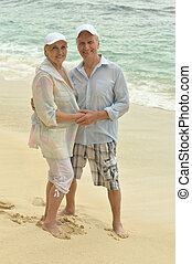 Elderly couple rest at tropical resort - Beautiful happy...