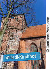 Street sign in front of the Wilhadi church in Stade, Germany