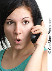 young woman is talking on a telephone