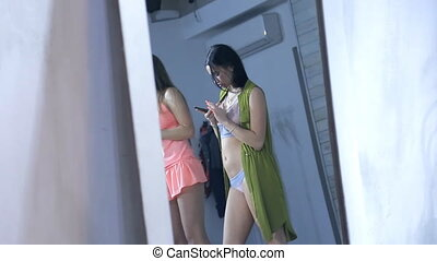 Models in lingerie before photosession mirror reflection...