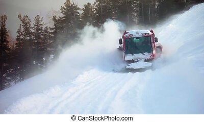 Red crawler ratrack near ski-route in mountains. - Red...