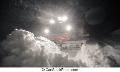 snow removal grooming at night