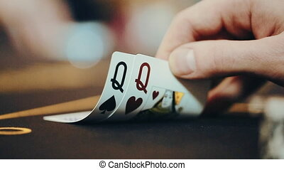 the poker player looks at the cards