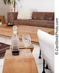 Champagne glasses with modern couch in background