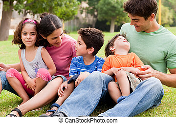 Happy family enjoying summer day in the park