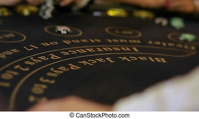 Cards being played at a blackjack table. close up.