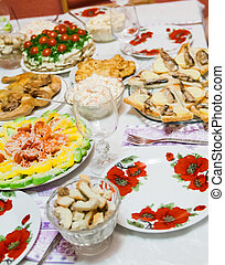 holiday table with dishes, with different dishes, salads