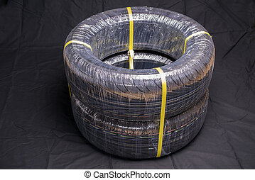 Packing automobile tires - Two packing automobile tires on...