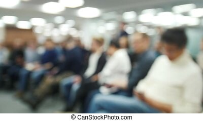Blurred background - seminar or lectures - a lot of people sitting at business meeting - time-lapse