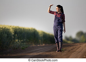 Farmer girl in wheat field - Young pretty farmer girl...