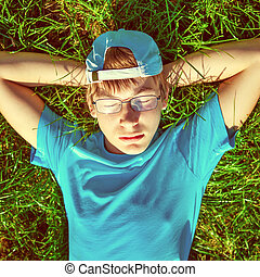 Boy on the Grass - Toned Photo of Teenager take a rest on...