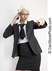 Young business woman with a phone in her hands.