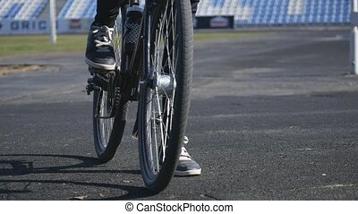 foot on pedal of bicycle.