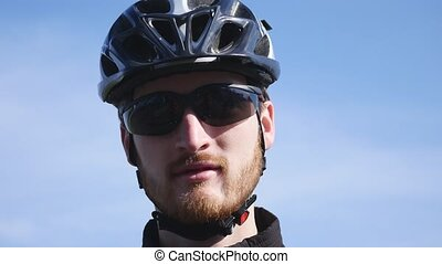 Handsome Young Man cyclist speaks by phone