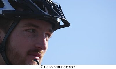 Bicyclist take off glasses close up.