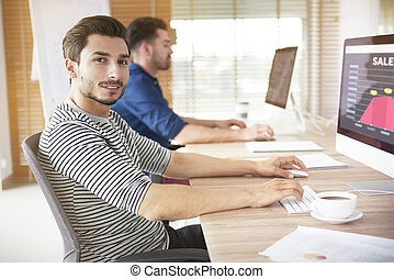 Office worker looking at camera