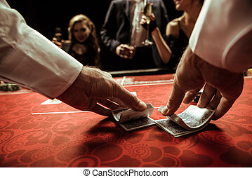 close up view of dealer shuffling cards in hands