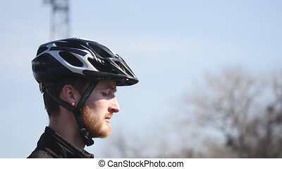professional cyclist with a beard wearing glasses.