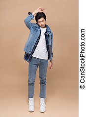 Full length of elegant young handsome asian man. Cool fashion male model.