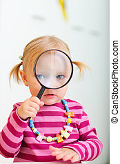 Toddler girl looking through magnifier - Curious toddler...