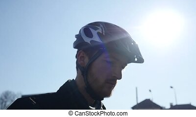 professional cyclist with a beard wearing glasses