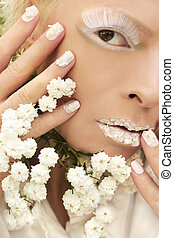 Makeup and manicure with petals of Gypsophilla.