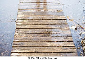 Wooden board walk on bog land in spring