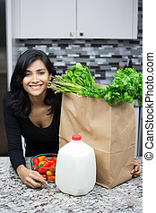 Nutritious food - Closeup portrait, young woman with bag...