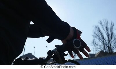 Male biker wearing sport gloves