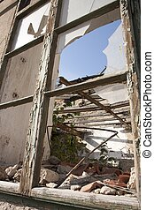Ruined house - broken window and ceiling