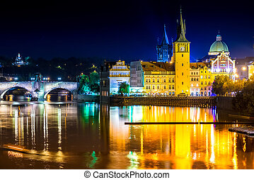 View of the Vltava river and Charles Bridge at dusk. Prague,...