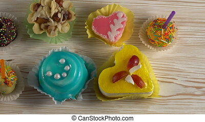 Delicious colourful cup cakes. - Delicious colourful cup...
