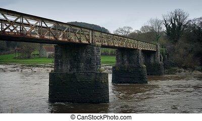 Old Train Bridge Over River