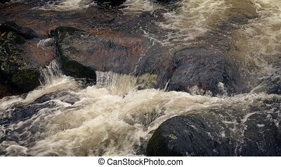 Big Mountain River Flowing Over Rocks - Fast flowing river...