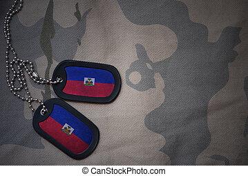 army blank, dog tag with flag of haiti on the khaki texture...