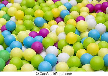 Colorfull plastic balls in children park closeup