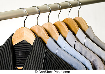 Dress Shirts on Hangers. - Dress shirts on wooden hangers.