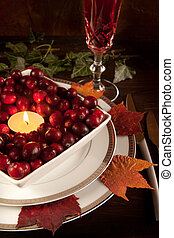Thanksgiving dinner table closeup with cranberries and...