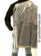 Man with Dry Cleaning - Rearview of man with dry cleaning...